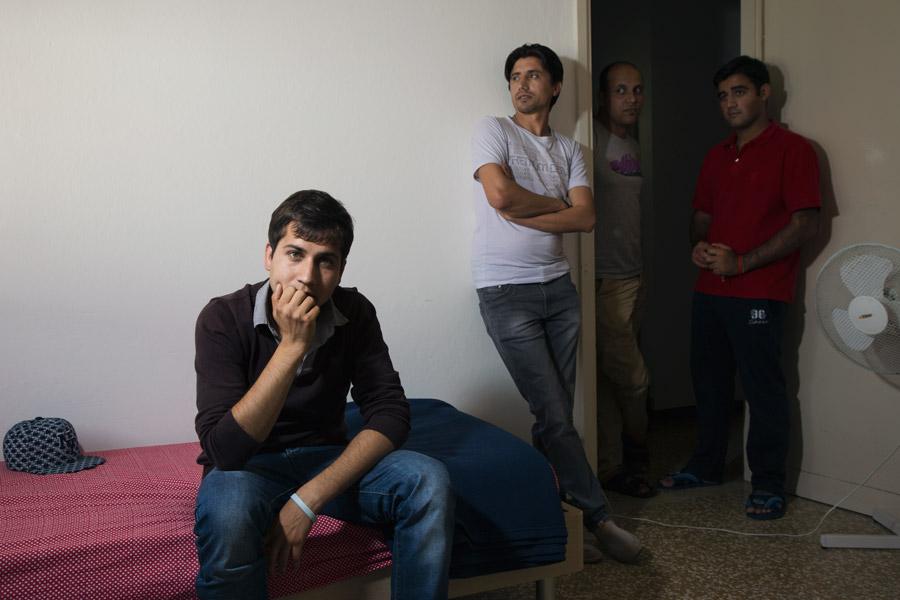 Nuovi vicini onlus caritas foto portrait rifugiati Alessandro Venier